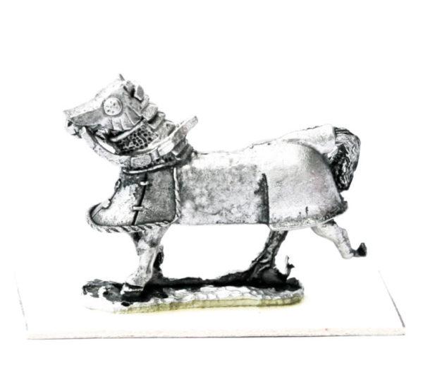 Barded Horse running