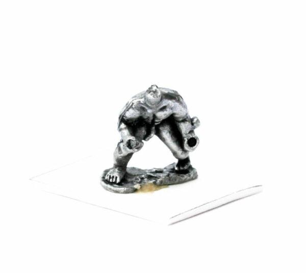 Nude warrior crouching